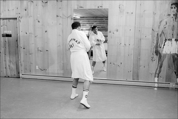 Madelyn Jordon Fine Art ALLAN TANNENBAUM: GRIT AND GLAMOUR Muhammed Ali shadow boxes at his Deer Lake, PA, training camp